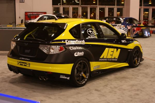 AEM's latest creation was at the Subaru booth complete with full Clarion install