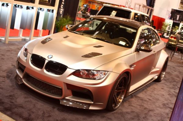 This M3 at the Wraptivo booth was  complete custom wrap overtop of a sexy widebody to attract a load of attention.